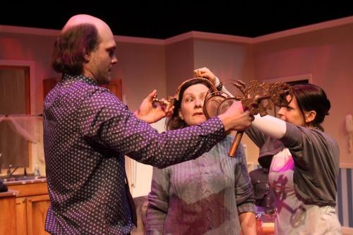 "David Zimmerman, Jennifer Mendendall, and Kimberly Gilbert in Forum Theatre's ""Pluto."""