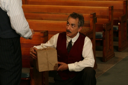 "Handle with Care: Cool Hand David Strathairn defuses a package bomb in ""No God, No Master."""