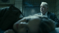 "Rachel McAdams & the late Phillip Seymore Hoffman in Anton Corbijn's ""A Most Wanted Man."""