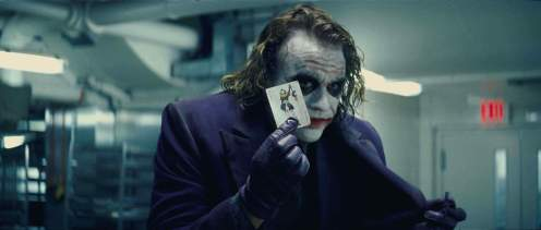 "Health Ledger as The Joker in Christopher Nolan's ""The Dark Knight"" (2008), the 10th-best summer blockbuster, according to us."