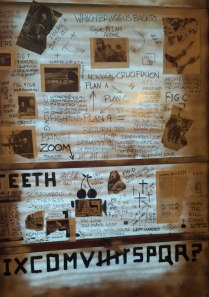 Collage on brown package paper affixed to interior window at Fort Fringe, Oct. 5, 2014