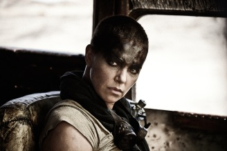 "CHARLIZE THERON as Furiosa in Warner Bros. Pictures' and Village Roadshow Pictures' action adventure ""MAD MAX: FURY ROAD,"" a Warner Bros. Pictures release. (Jasin Boland)"