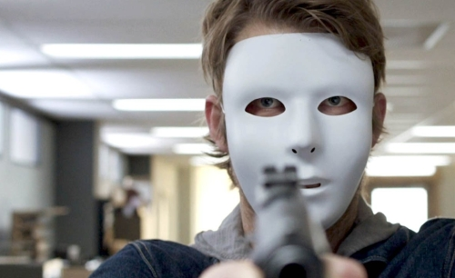 "Luke Mitchell has a mask and a gun, but not a plan, in ""7 Minutes."""