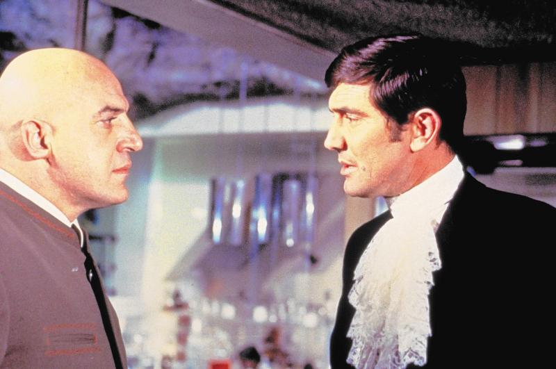 """One-off Blofeld Telly Savalas meets one-off 007 George Lazenby in """"On Her Majesty's Secret Service,"""" 1969."""
