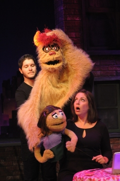 """Christian Montgomery and Vaughn Ryan Midder (hidden behind the puppet) as Trekkie Monster and Katy Carkuff as Kate Monster in Constellation's """"Avenue Q."""" (Stan Barouh)"""