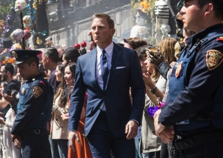 Bond (Daniel Craig) following Marco Sciarra through the Dia de los Muertos procession in Metro-Goldwyn-Mayer Pictures/Columbia Pictures/EON Productions' action adventure SPECTRE. Tolsa Square, Mexico City.
