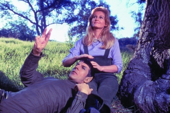 """Leonard Nimoy and Jill Ireland in the 1967 Original Series episode """"This Side of Paradise,"""" wherein the rational half-Vulcan Mr. Spock finds love while under the influence of a strange plant. (CBS Consumer Products/Star Trek Archive)"""