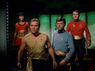"Nichelle Nichols, William Shatner, DeForest Kelley, and James Doohan in ""Mirror, Mirror,"" which first aired Oct. 6, 1967. (CBS Consumer Products/Star Trek Archive)"