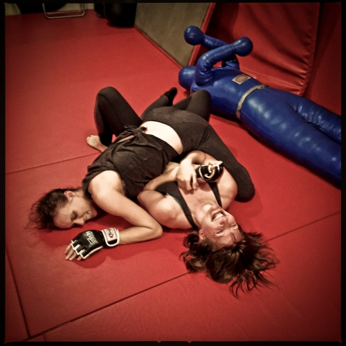 """Audrey Bertaux and Jennifer J. Hopkins grapple in rehearsal for """"The Girl in the Red Corner."""" (Darrow Montgomery)"""
